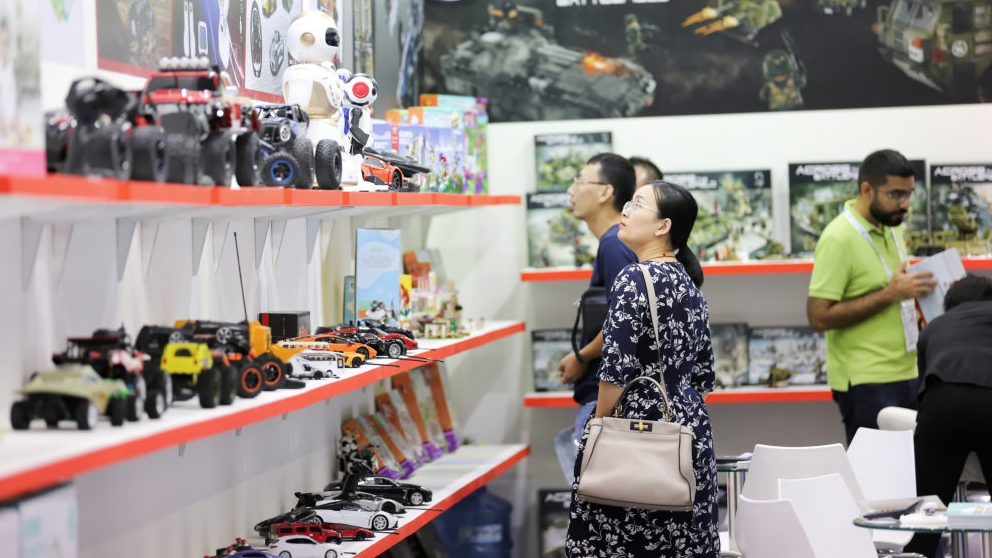 lady looking at toys and Just DK