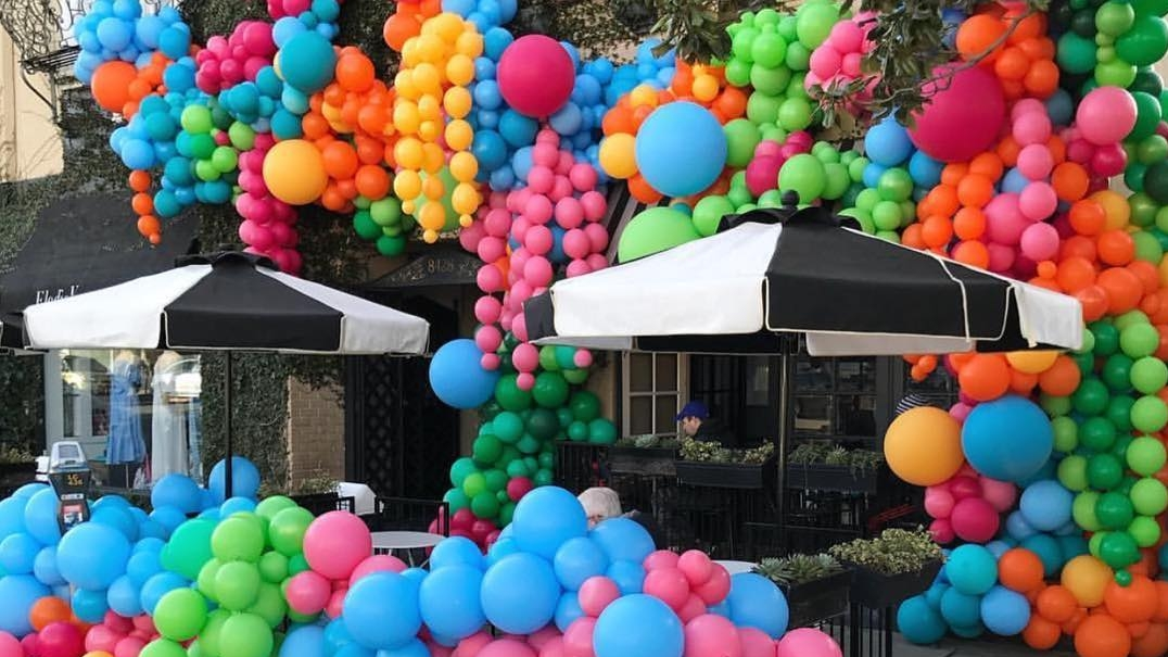 colorful balloons in the street for paperworld middle east