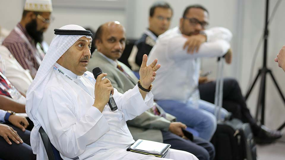 man asking questions at paperworld middle east seminar