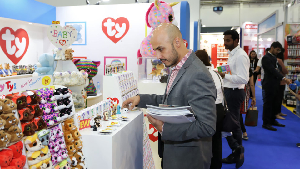 man exploring Ty products in playworld village of paperworld middle east