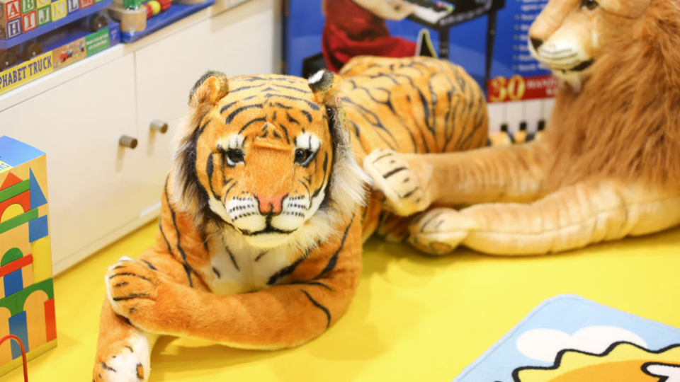 toy tiger in playworld village at paperworld middle east