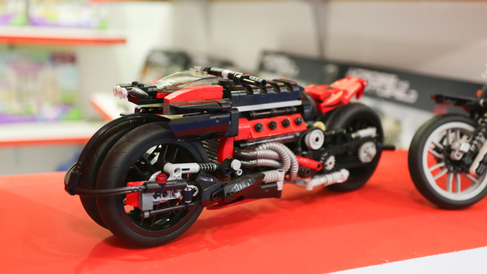toy motorbike in playworld village at paperworld middle east